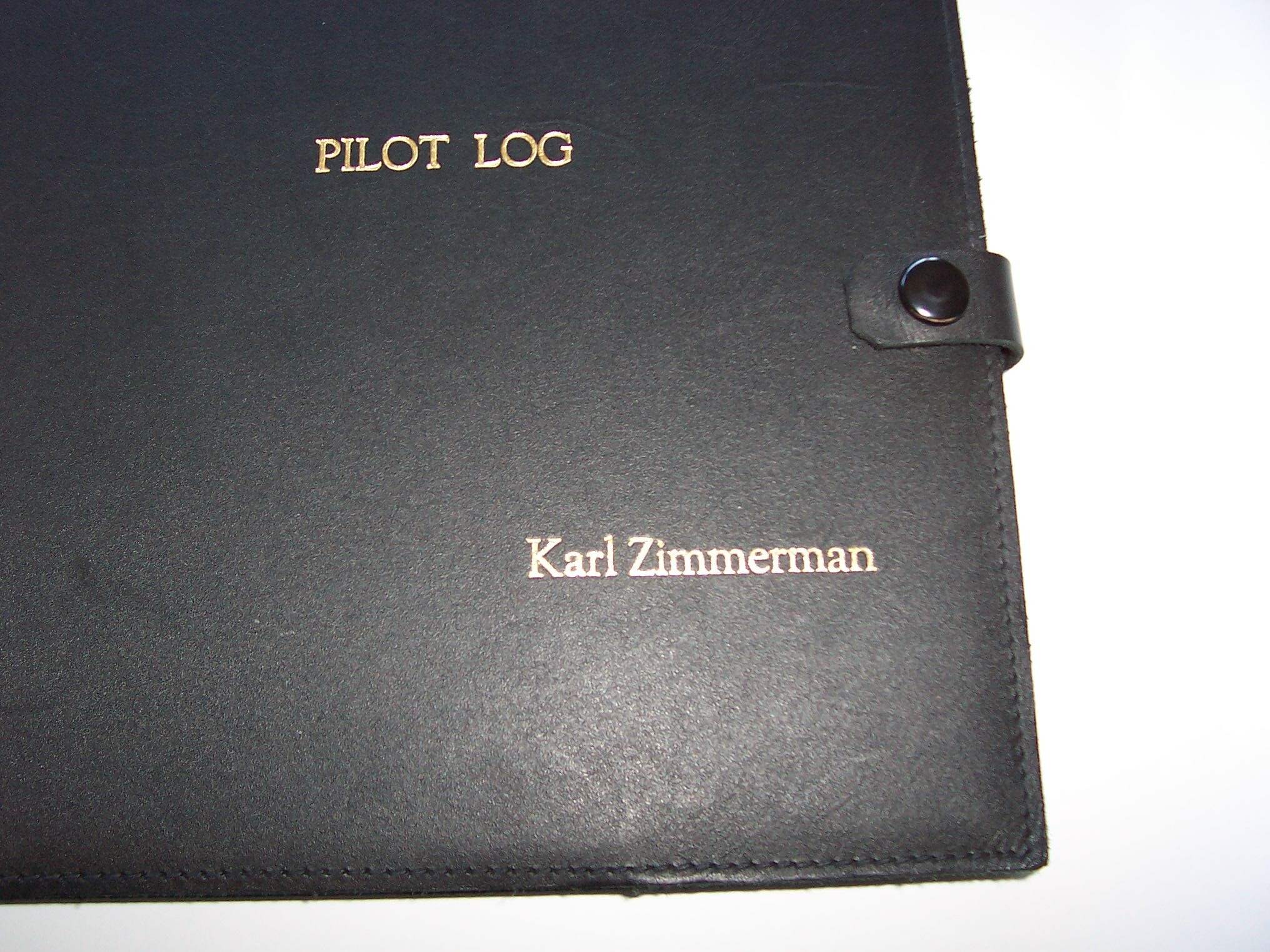 Black Leather Book Cover : Have your name embossed in gold on the black leather pilot