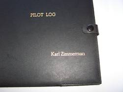 Personalised name embossing on black leather pilot log book cover